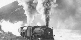 Locomotive 5810 leads an eastbound freight train departing Field, 1940s