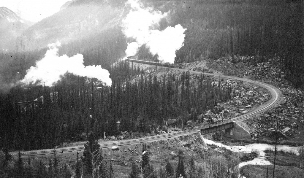 Construction tote road in the Kicking Horse Canyon with the railbed taking shape below, ca. 1884