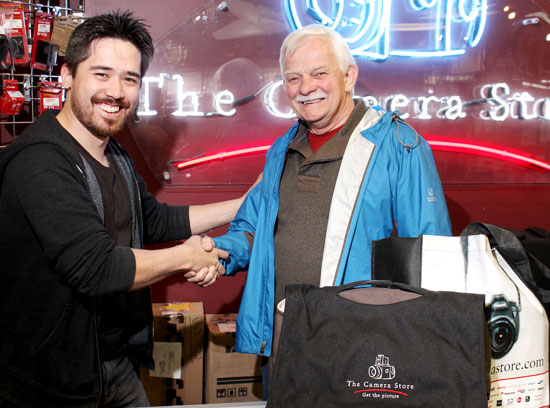 Lloyd Dykstra (pictured on right) was the Grand Prize Winner in the Landscapes & Sunsets Category of our 2012 Photo Contest. On the left, Chris Niccolls of The Camera Store presents Lloyd with his prize: a High Definition Camera Outfit (approx retail value of $1,500) courtesy of The Camera Store in Calgary, Alberta.