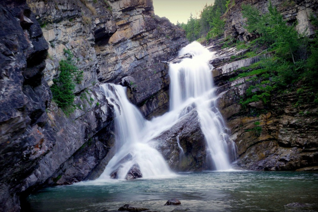 Cameron Falls in Waterton National Park - by John Hardy
