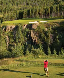The author teeing it up on the famous Cliffhanger hole at Greywolf Golf Course.